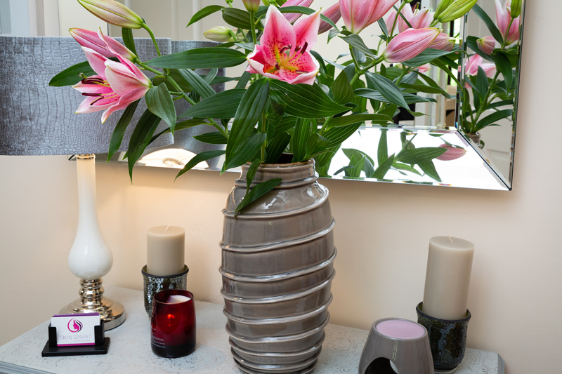 Pink lillies and grey lamp